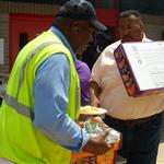 Mayor Glover helping with food 2